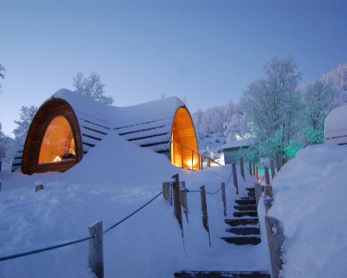 see the Northern Lights from the warmth of your own Gamme Cabin at the Kirkenes Snow Hotel