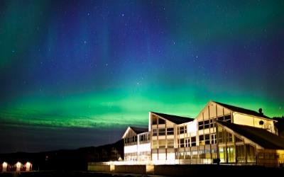 stay at the Malangen Resort to see the Northern Lights in Norway